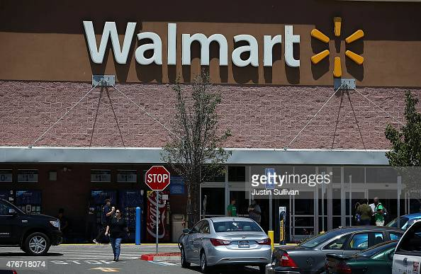 Customers leave a WalMart store on June 11 2015 in Oakland California A federal judge has ruled that WalMart failed to pay the California minimum...