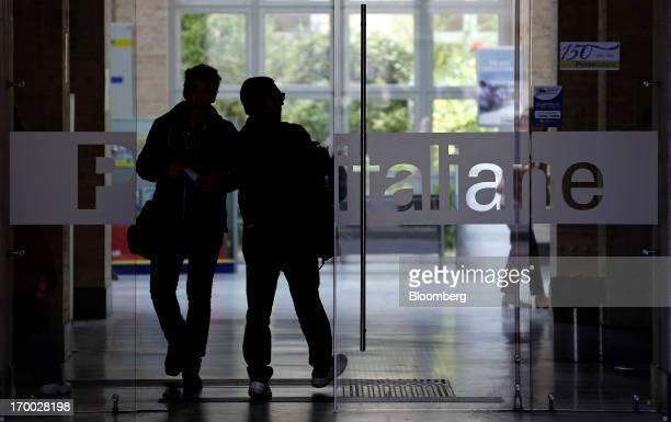 Customers leave after being served inside a Poste Italiane SpA post office in Rome Italy on Wednesday June 5 2013 Rome based Poste Italiane boosted...