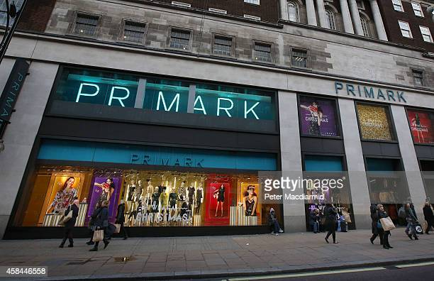Customers leave Primark's flagship store on Oxford Street with their purchases on November 5 2014 in London England Retail giant Marks and Spencer...