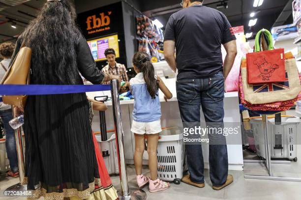 Customers line up at the checkout counters inside a Fashion @ Big Bazaar store the fashion unit of Big Bazaar hypermarkets operated by Future Retail...