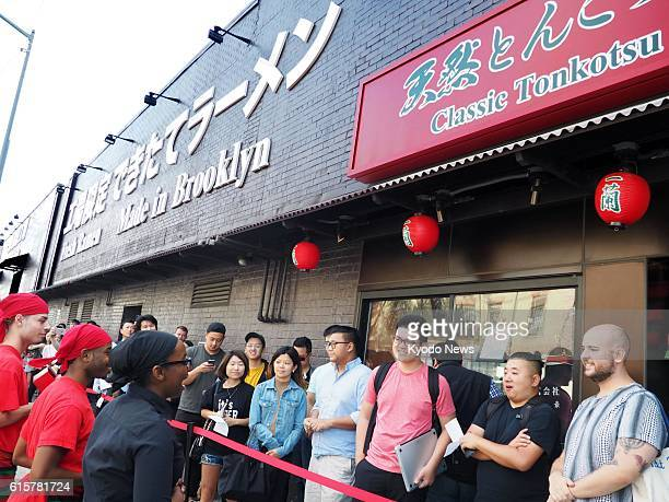 Customers line up in front of a new ramen noodle restaurant 'Ichiran' in New York on Oct 19 waiting for it to open It is the second overseas branch...