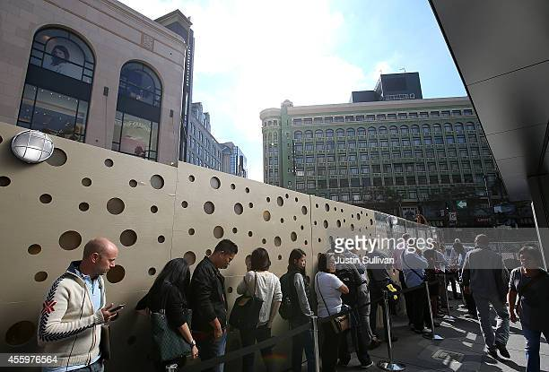 Customers line up in front of an Apple Store to purchase the new iPhone 6 on September 23 2014 in San Francisco California Less than one week after...
