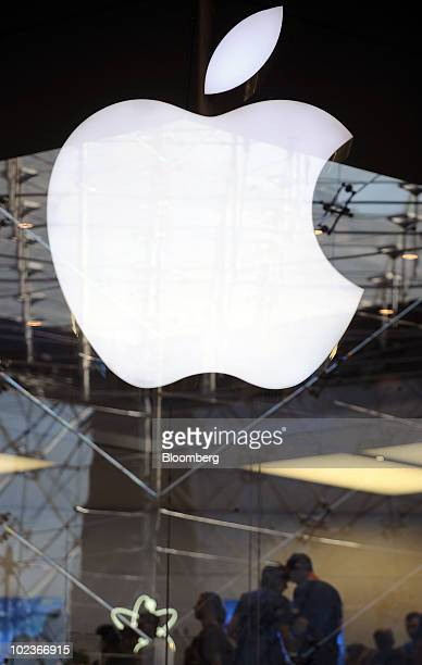 Customers line up outside the Apple Inc store to purchase iPhone 4 smart phones at the Carrousel du Louvre in Paris France on Thursday June 24 2010...