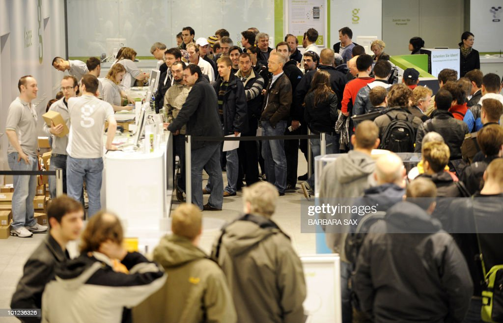 Customers line up to buy Apple's new iPad as it is launched in a shop in Berlin on May 28, 2010. The iPad, a flat, 10-inch (25-centimetre) black tablet targeted at the leisure market -- was going on sale in Japan, Australia, Britain, Canada, France, Germany, Italy, Spain and Switzerland as part of a staggered global roll-out.