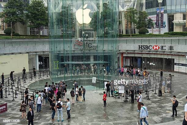 Customers line up to enter an Apple store on September 25 2015 in Shanghai China Apple launched the new iPhone 6s and iPhone 6s Plus on September 25...