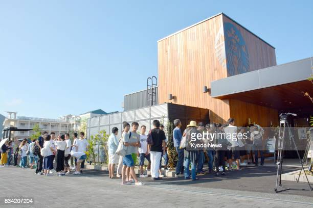 Customers line up to enter the Starbucks coffee shop in the western Japan city of Yamaguchi on Aug 18 its opening day Yamaguchi was the only...