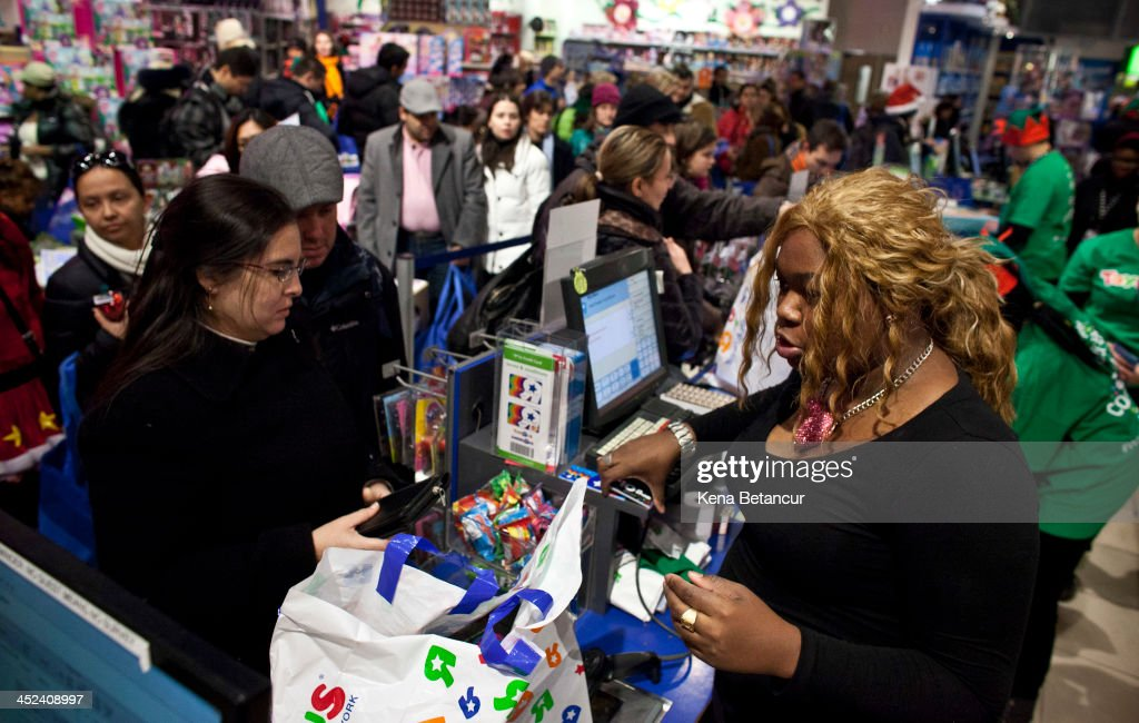 Customers line up to pay for their items at Toys'R'Us in Times Square on Thanksgiving day on November 28, 2013 in New York City. Black Friday shopping began early again this year with most major retailers opening their doors on Thanksgiving day.