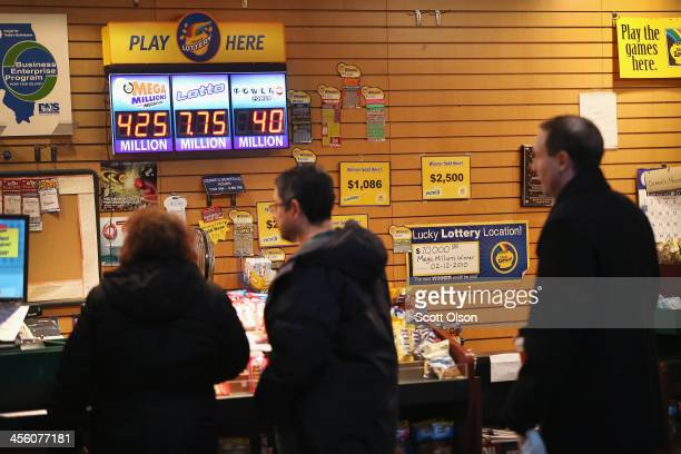 Customers line up to purchase lottery tickets at Debbie's Newstand on December 13 2013 in Chicago Illinois Tonight's Mega Millions jackpot will be an...