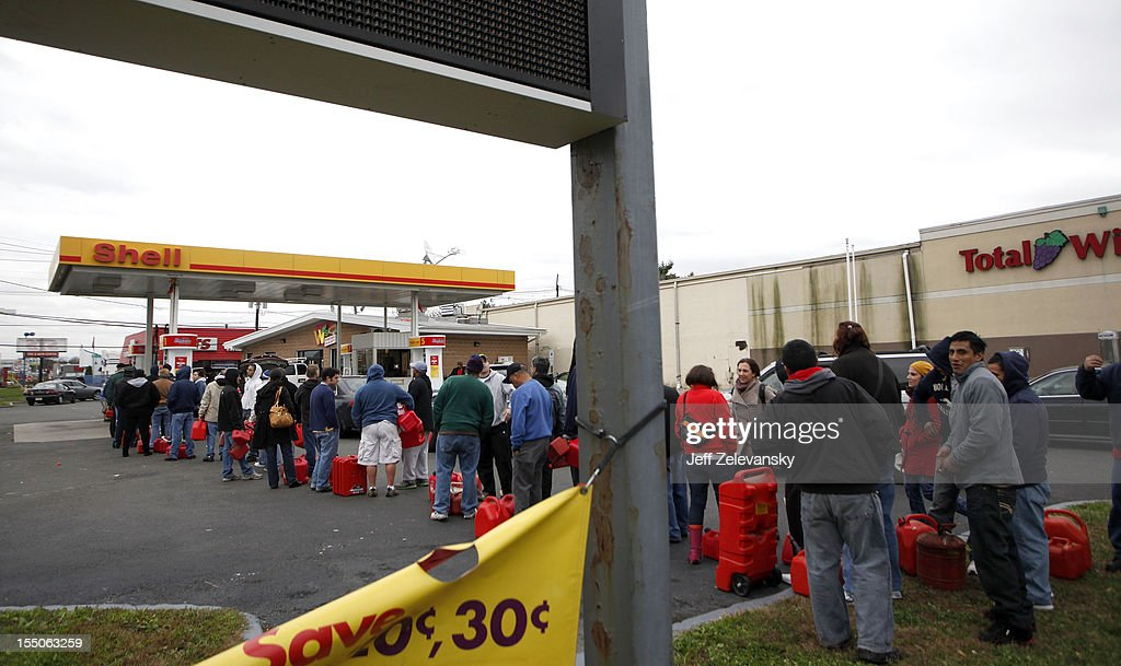 Customers line up to refill gasoline tanks along Route 22, October 31, 2012 in Union, New Jersey. Though nearly lined with gas stations, only two had both electricity and fuel to dispense as residents contiue to cope with widespread damage and region-wide power outages resulting from Hurricane Sandy.