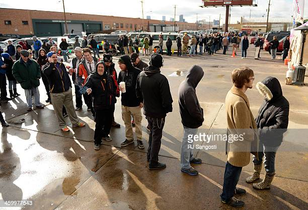 Customers lineup to buy recreational marijuana at 3D Cannabis Center in Denver January 01 2014 It was up to a fourhour wait at the shop to buy...