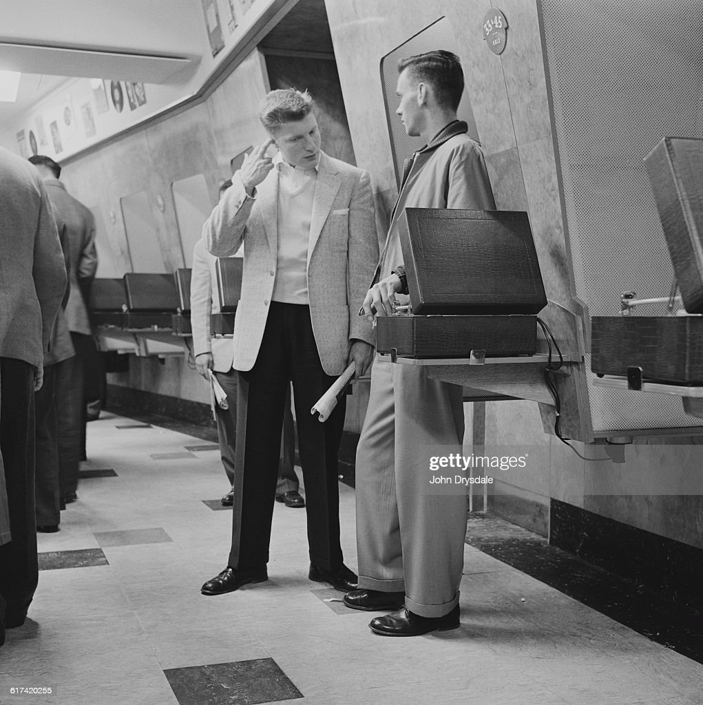 Customers listen to the latest record releases at listening booths in the HMV shop at 363 Oxford Street London 24th November 1955 The records are...