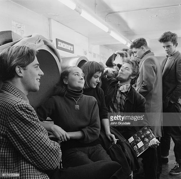 Customers listen to the latest record releases in soundproof listening booths at Imhof's Melody Bar in New Oxford Street London 24th November 1955