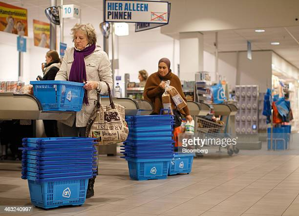 Customers load their food purchases onto checkout conveyors inside a Albert Heijn XL store operated by Royal Ahold NV in Utrecht Netherlands on...