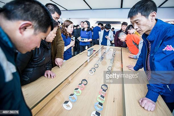 Customers look at Apple Inc Apple Watch smartwatches displayed at an Apple Store near West Lake on April 10 2015 in Hangzhou Zhejiang province of...