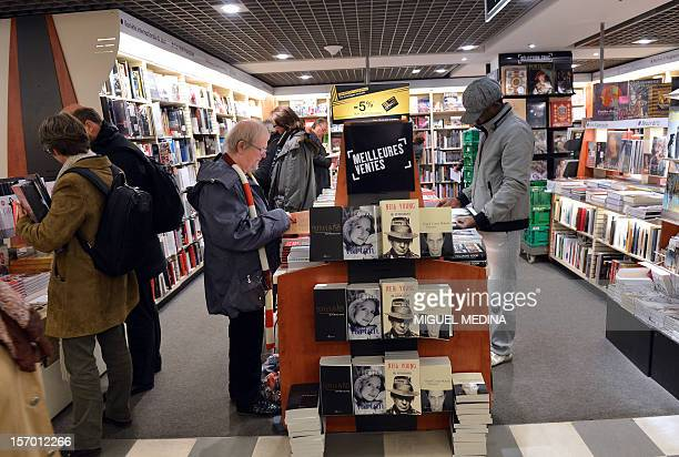 Customers look at books displayed at a FNAC store on November 27 2012 in Paris AFP PHOTO MIGUEL MEDINA