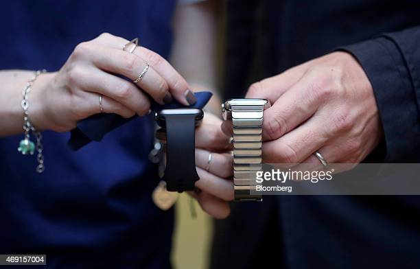 Customers look at different versions of an Apple Watch smartwatch during a preview event at Apple Inc's Covent Garden store in London UK on Friday...