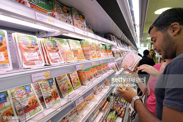 Customers look at food products in a department of a 100% halal food shop the Hal'Shop on August 1st in Nanterre a western suburb of Paris as the...
