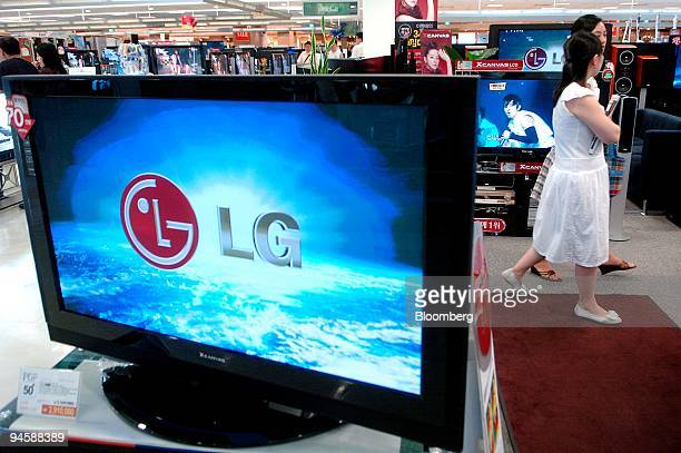 Customers look at LG Electronic Cos LCD TV sets at an electronics shop in Seoul South Korea on Sunday July 8 2007 Asian stocks rose for a second day...
