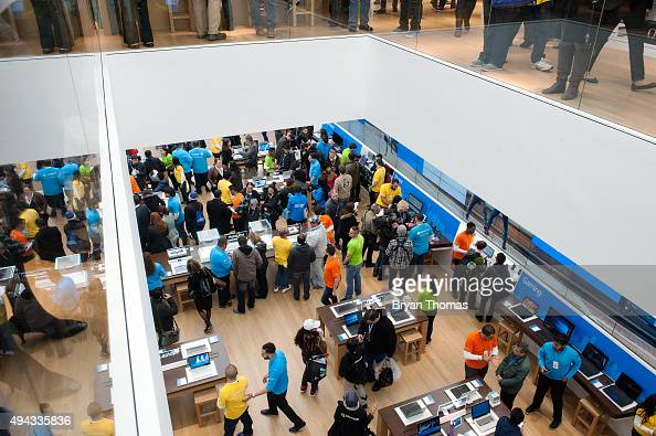 Customers look at merchandise at Microsoft's first flagship store on Fifth Avenue on October 26 2015 in New York City Hundreds of eager customers...