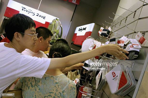 Customers look at merchandise featuring the logo for the 2008 Olympic Games on August 6 in a store in Beijing China Today China started to sell...
