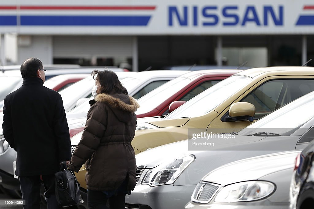 Customers look at Nissan Motor Co. second-hand vehicles displayed at a dealership in Yokohama, Kanagawa Prefecture, Japan, on Friday, Feb. 8, 2013. Nissan, Japan's second-biggest carmaker, reported third-quarter profit that fell short of analysts' estimates, after sales tumbled in China and new models trailed competitors in the U.S. Photographer: Kiyoshi Ota/Bloomberg via Getty Images