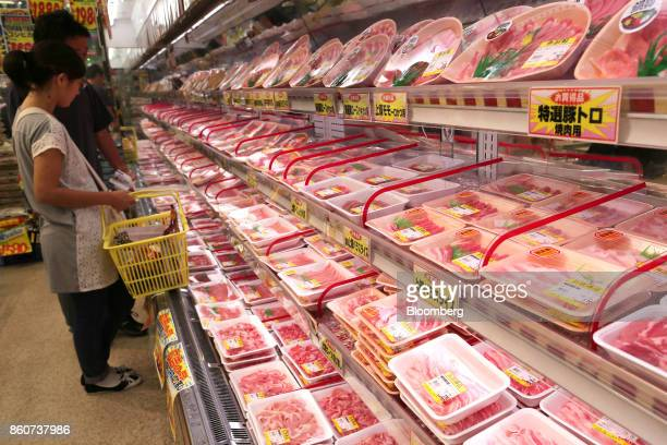 Customers look at packs of meat on shelves at a Super Tamade KK supermarket in the Tenjinbashi district of Osaka Japan on Monday Oct 9 2017 Amid the...