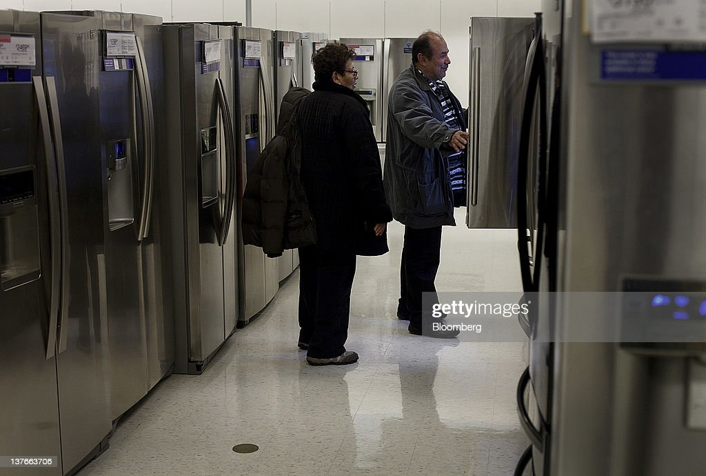 Customers look at refrigerators at a Sears Holdings Corp. store in Jersey City, New Jersey, U.S., on Tuesday, Jan. 24, 2012. The U.S Census Bureau is scheduled to release durable goods data on Jan. 26. Photographer: Victor J. Blue/Bloomberg via Getty Images