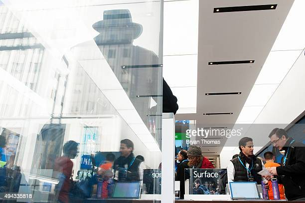 Customers look at the Microsoft Surface at Microsoft's first flagship store on Fifth Avenue on October 26 2015 in New York City Hundreds of eager...