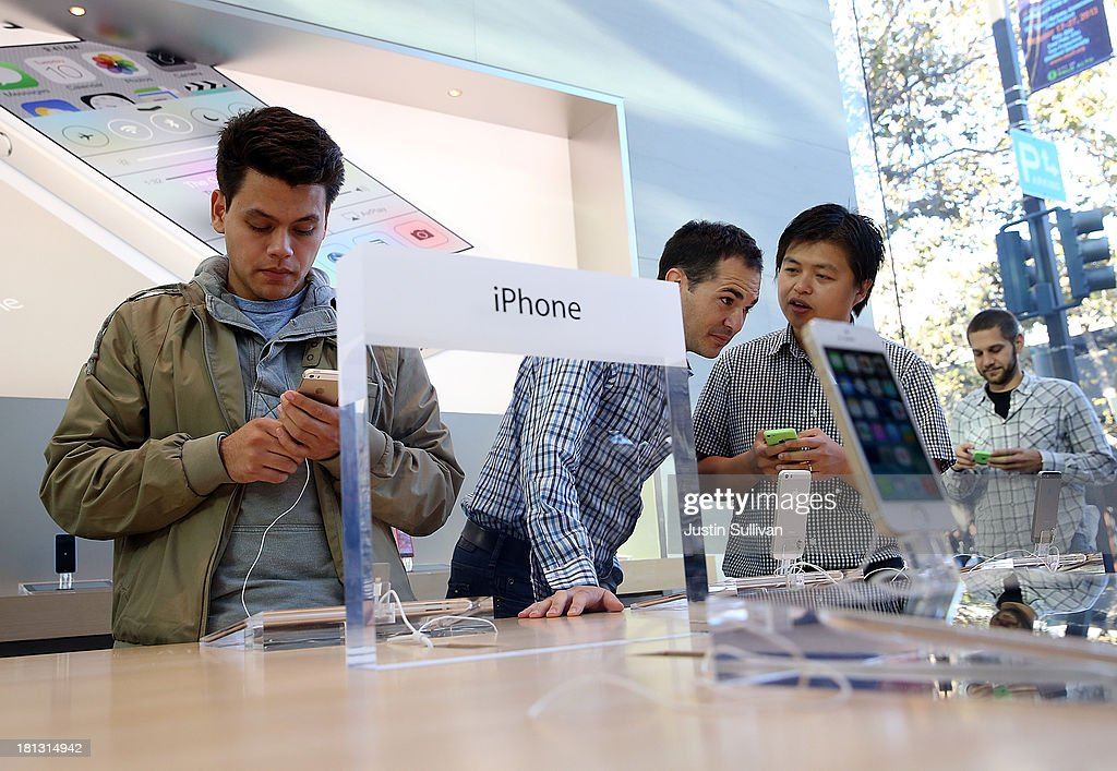 Customers look at the new Apple iPhone 5C at an Apple Store on September 20, 2013 in Palo Alto, California. Apple launched two new models of iPhone: the iPhone 5S, which is preceded by the iPhone 5, and a cheaper, paired down version, the iPhone 5C. The phones come with a new operating system.