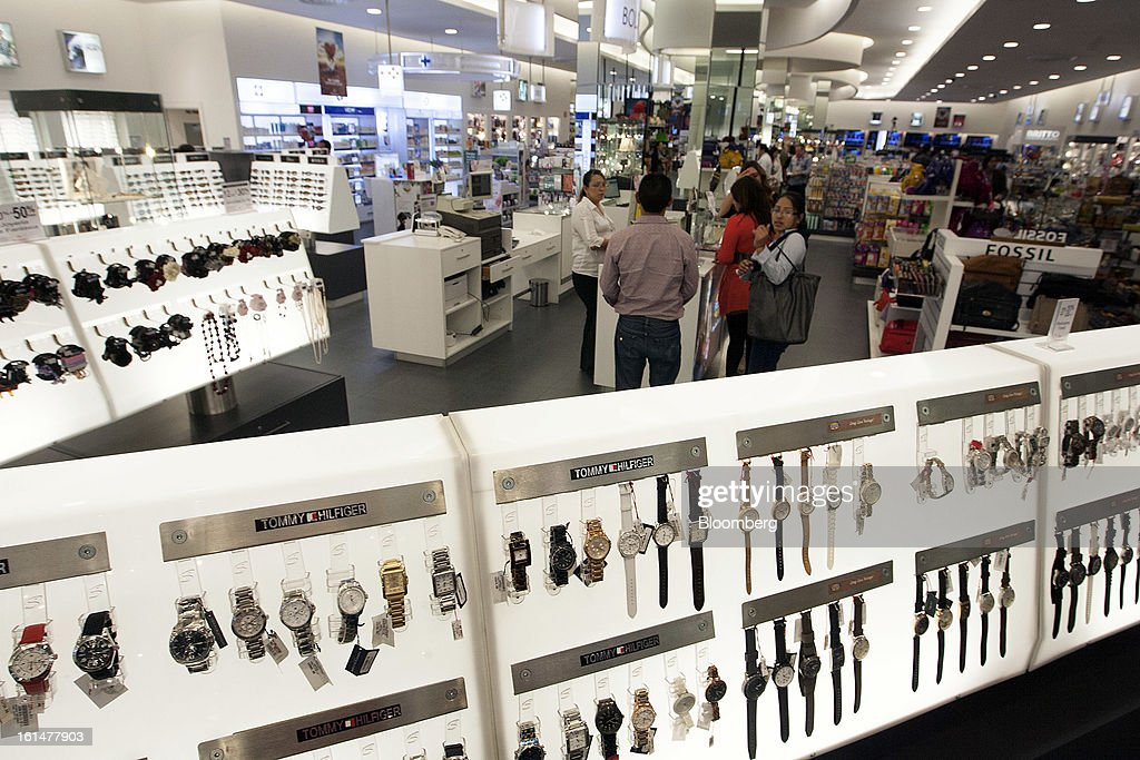 Customers look at watches at a Grupo Sanborns SAB store in the Plaza Carso development in Mexico City, Mexico, on Friday, Feb. 8, 2013. Grupo Sanborns SAB, the retailer controlled by Mexican billionaire Carlos Slim, raised 10.5 billion pesos ($825 million) in an initial public offering (IPO) last week and the total could climb to 12.1 billion pesos including an overallotment option for underwriters. Photographer: Susana Gonzalez/Bloomberg via Getty Images