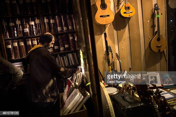 Customers look for bargains at Musical Emporium during its last day open to the public on January 5 2015 in Barcelona Spain Musical Emporium is a...