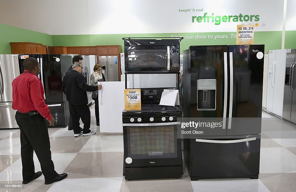 Customers look over appliances being offered for sale at an hhgregg store on October 15, 2012 in Niles, Illinois. Retail sales rose 1.1 percent last month with electronics and appliances leading the way with a 4.5 percent increase in sales.