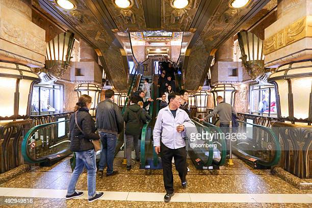 Customers make their way down the Egyptian staircase inside the luxury departmentstore chain Harrods Ltd in London UK on Thursday Oct 15 2015 The UK...