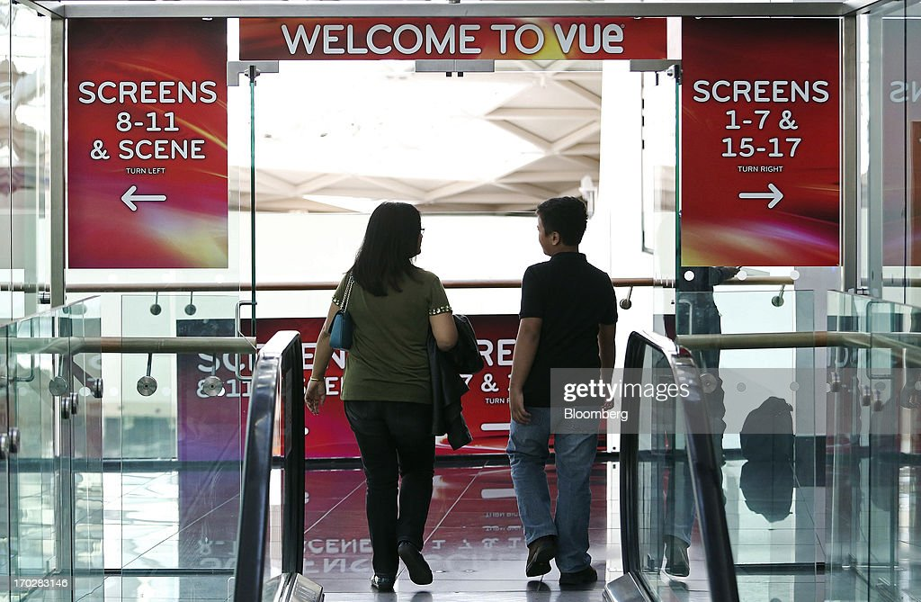 Customers make their way towards a screen to watch a film inside a Vue Cinema, operated by Vue Entertainment Ltd., at the Westfield Stratford City retail complex in London, U.K., on Tuesday, June 4, 2013. Vue Entertainment, the U.K. cinema chain bought by private equity firm Doughty Hanson & Co., are continuing to expand in Europe, recently acquiring Poland's second-largest cinema chain Multikino. Photographer: Chris Ratcliffe/Bloomberg via Getty Images