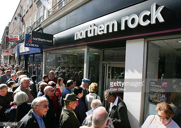Customers of Northern Rock queue outside the Kingston branch of the company on Castle Street in order to take their money out of their accounts on...