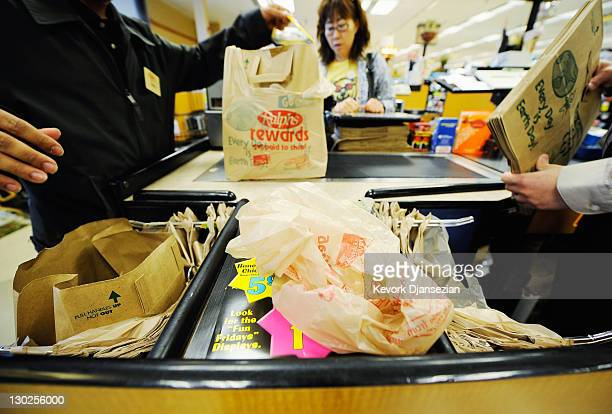 Customers of Ralphs supermarket use plastic bags to carry their groceries home on October 25 2011 in Glendale California The Glendale City Council is...