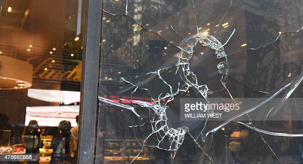 Customers order at the counter of the Lindt Cafe scene of the December 15 deadly siege which saw the deaths of two hostages and the gunman with...