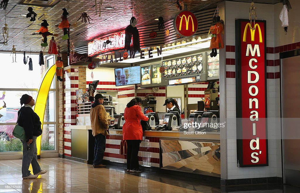 Customers order food from a McDonald's restaurant on October 24, 2013 in Des Plaines, Illinois. McDonald's has announced it will make changes to its low-priced Dollar Menu, which includes items like coffee, small fries, hamburgers and apple pies. The new menu, dubbed the Dollar Menu and More, will offer some higher priced options such as the grilled Onion Cheddar Burger and a McChicken sandwich.