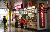 Customers order food from a McDonald's restaurant on October 24 2013 in Des Plaines Illinois McDonald's has announced it will make changes to its...