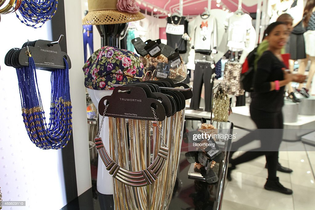 Customers pass fashion accessories on display inside a Truworths International Ltd fashion store in Sandton South Africa on Tuesday Aug 12 2014 South...