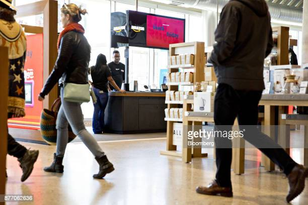 Customers pass in front of an Amazoncom Inc PopUp store inside the Lakeview Whole Foods Market Inc store in Chicago Illinois US on Monday Nov 20 2017...