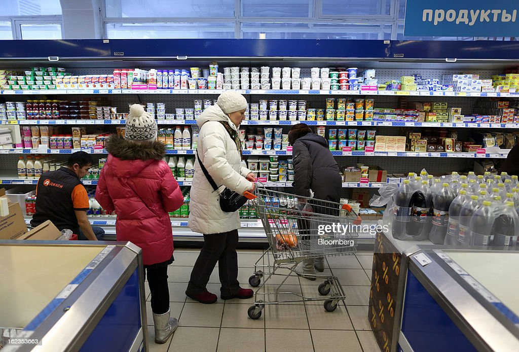 Customers pass the chilled dairy section inside a supermarket operated by OAO Dixy Group in Moscow, Russia, on Friday, Feb. 22, 2013. Russia's largest retailer by market value, OAO Magnit, is spending as much as $1.8 billion this year to compete against X5 Retail Group NV and OAO Dixy Group. Photographer: Andrey Rudakov/Bloomberg via Getty Images