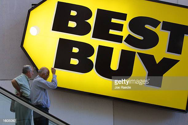 Customers pass underneath a Best Buy sign July 27 2001 in MiamiDade County FL Consumers are being lured by backtoschool sales and a special statewide...