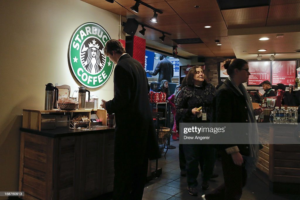 Customers patronize a Starbucks inside Union Station, on December 27, 2012 in Washington, DC. Starbucks CEO Howard Schultz announced Washington locations would serve coffee with the words 'come together' written on the cups intended as a message to lawmakers about the damage being caused by the divisive negotiations over the 'fiscal cliff.'
