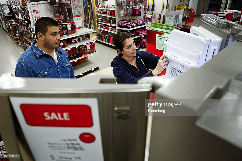 Customers Paul Galvez, left, and Mairet Sandoval shop for a refrigerator at the Sears store during the Family and Friends evening sale inside the Del Amo shopping mall in Torrance, California, U.S., on Sunday, Nov. 11, 2012. Sears Holdings Corp., the retailer controlled by hedge-fund manager Edward Lampert, fell the most in more than 10 months on Nov. 16, after posting a wider third-quarter loss and its 23rd straight quarterly sales decline. Photographer: Patrick Fallon/Bloomberg via Getty Images