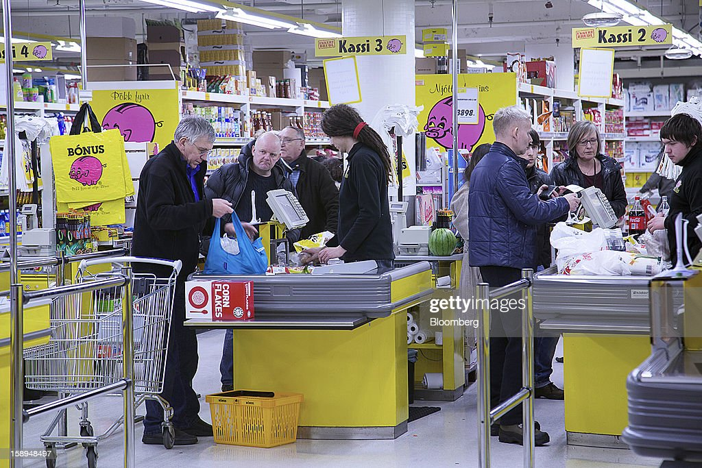 Customers pay for goods at cash desks inside a Bonus grocery store, owned by Baugar Group hf, in Reykjavik, Iceland, on Wednesday, Jan. 2, 2013. Creditors of Iceland's three biggest failed banks are fighting for a waiver to krona controls imposed in 2008 amid risks pay-outs will be delayed beyond 2015. Photographer: Arnaldur Halldorsson/Bloomberg via Getty Images