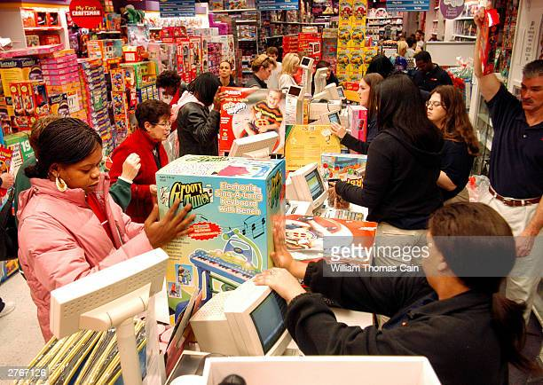 Customers pay for their items while doing their Black Friday shopping at KB Toys which opened at 5am in the King of Prussia Mall November 28 2003 in...