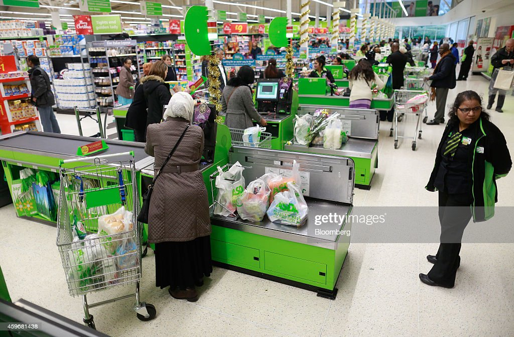 Customers pay for their shopping at selfserve checkout counters inside an Asda supermarket operated by WalMart Stores Inc in the Wembley district of...