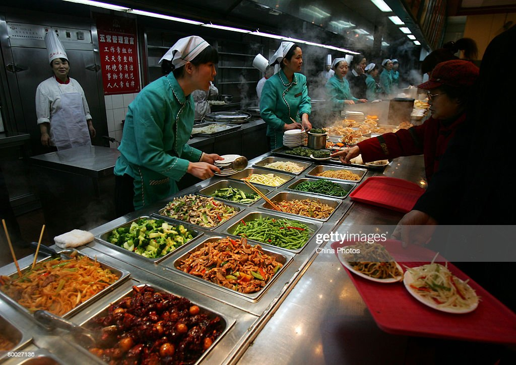 Customers pick food during a buffet dinner in a restaurant on February 27 2008 in Xian of Shaanxi Province China China said it is making full efforts...