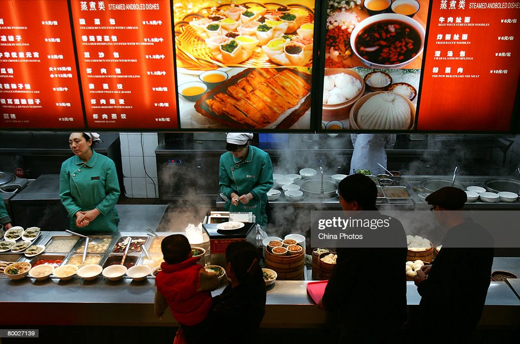 Customers pick food during in a restaurant on February 27 2008 in Xian of Shaanxi Province China China said it is making full efforts to ensure food...